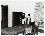 [Casa del Hidalgo interior, showing second story dining room with hostess Maria Hugas Acebal]