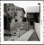 South patio of Arrivas House during restoration, looking East, 1961