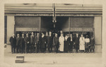 Staff of the Stephens and Coe drug store, posing for a Christmas photo