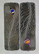 Push plate: peacock feather motif