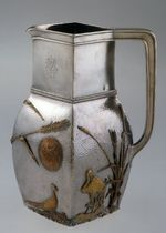 Pitcher: reed, bird and plant motif