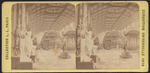 (Statues near booth at Exposition Universelle 1878)
